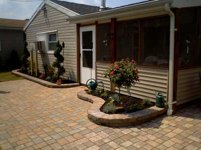 large paver patio with garden inserts