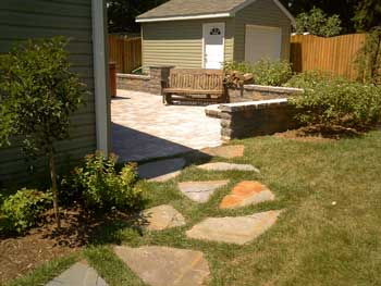 hardscapes add beauty and function to this back yard