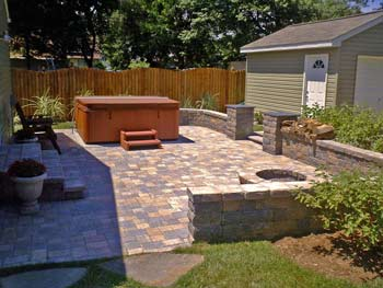 patio, retaining wall, steps, fire pit and stepping stones by Clayton Landscaping