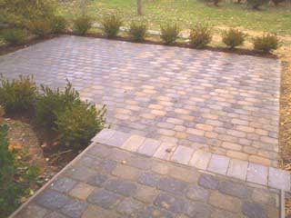 stone paver patio with landscaping