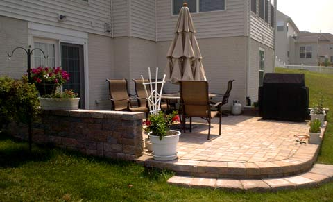 townhouse patio with retaining wall, steps and accent garden
